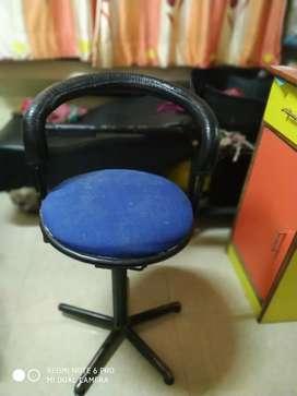 Hydrolic chair.