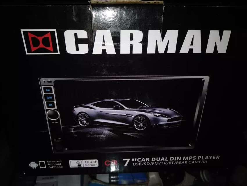 Headunit dobeldin merk Carman mp4