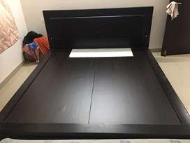 A low lying well furnished king size cot