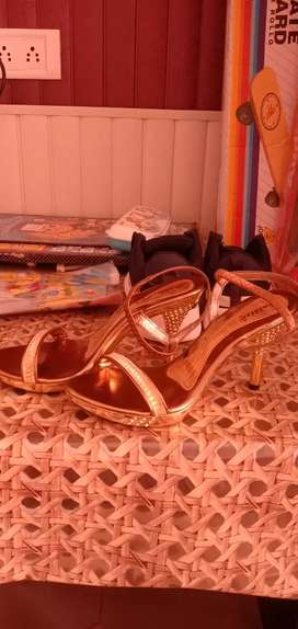 Golden sandals high heel