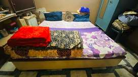 King size bed with mattress and headboard storage