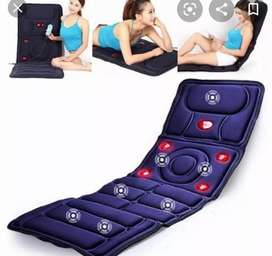 Massage mattress emits soothing heat providing a relaxing massage .