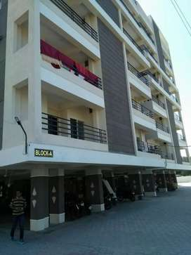 Resale 1bhk flat with modular kitchen , car parking , lift and garden