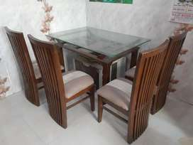 Teakwood Dining table with 4 chairs.