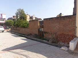 Corner facing plot in a very good residential society with 30ft Road