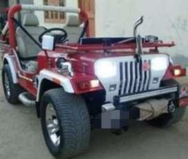 Mahindra red sports jeep