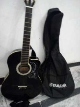 Semi accoustic guitar of MBAT company with bag and extra strings, pick