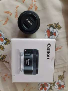 50mm Mint condition canon lens with bill no bargain.
