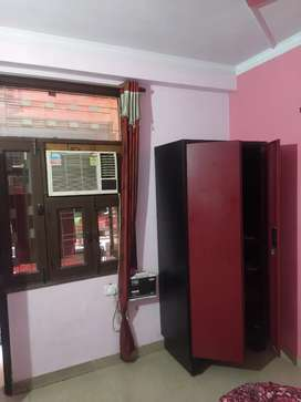 It's a 2bhk appratment with kitchen and wardrobes and bed.