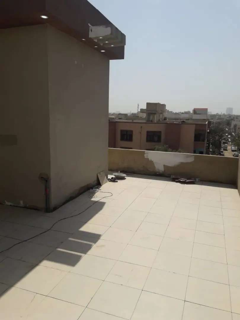 Brand New portion Kaneez Fatima society 400 sqyd 3rd floor with roof