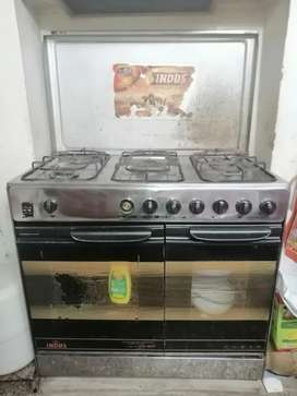 Indus 5 Burner cooking range with oven portion and Baking Portion