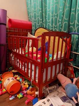 Wooden cot with mosquito net