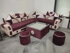 Six seater sofa with table and puffy