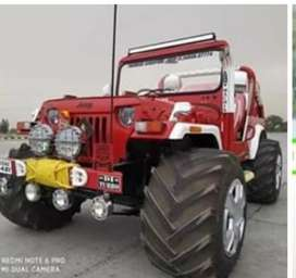 Modified open Willy red jeep