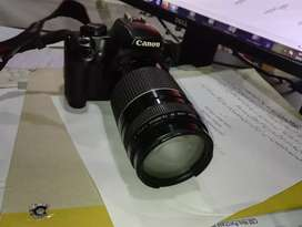 Canon camera with 300 mm lens and 55 mm