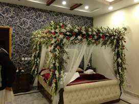 Fresh flowers Wedding bed wedding room decor available