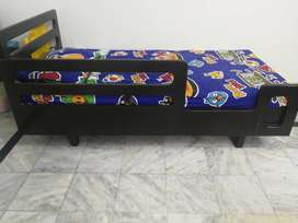 Toddler's bed in brown color