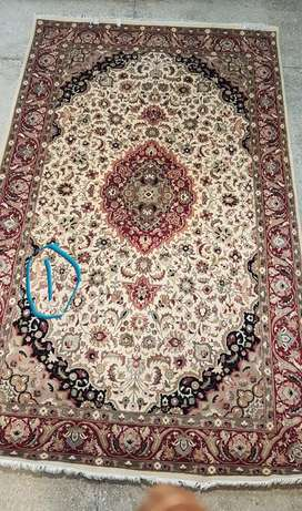 Persian design hand knotted woollen carpets, Rs.1,625 per square foot