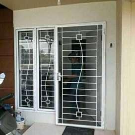 Pintu doubel desigs pintu teralis anti maling
