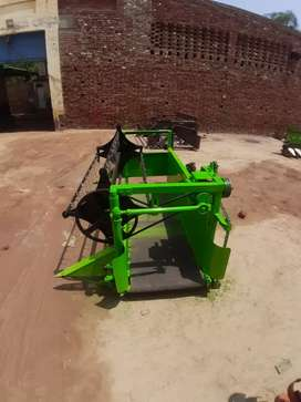Tractor mounted reaper for crops