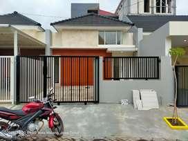 Rumah kawasan Dinoyo Malang hadap timur
