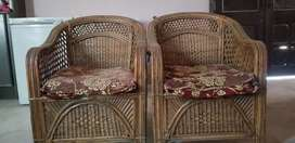 5 seater cane sofa set with 3 tabels and a rack.