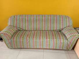 Three seater sofa with cover
