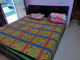 Double bed with compartment