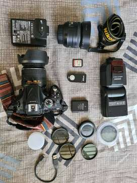 NIKON D5200 DSLR with18-55MM and 35MM prime lens
