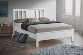 White double bed with 2 tables