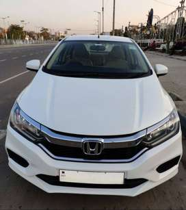 Self driven and maintained white Honda City 2018