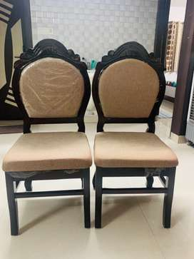 Two new wooden chairs