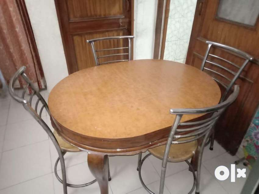 4 Seater solid wooden dining table with 4 chairs 0