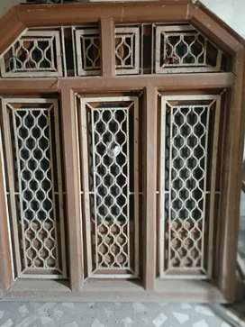 Iron window with wooden frame