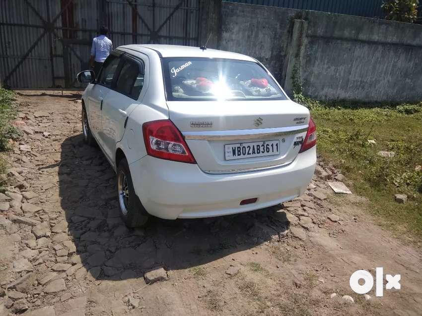 I want to buy a new car so I want to sale my old dzire white car 0