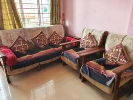 Sofa set with cushions and covers