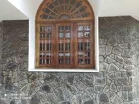Marble floored house behind EMC with teak wood warrobes