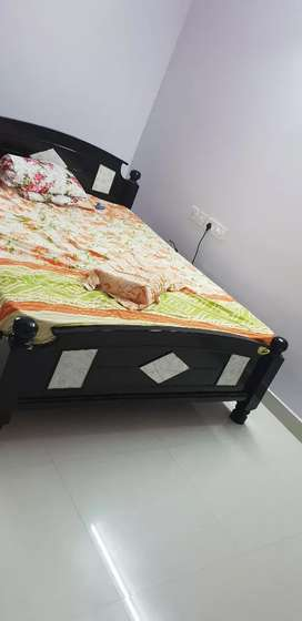 Queen sized bed with mattress