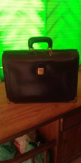 A Black Leather Detailing bag is for sale