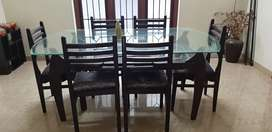 Glass top wooden dining table with 6 chairs