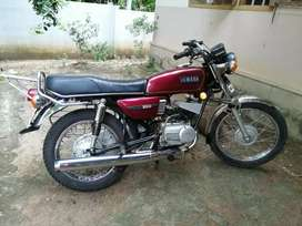 Rx100 showroom condition . All papers clear back yezdi drim and tyre