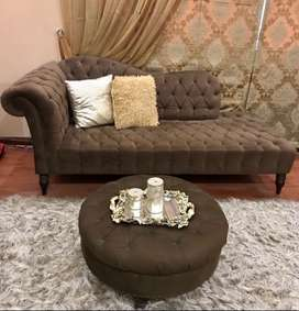 tufted couch with ottoman and two cushions