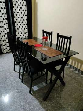 New dining table  and chairs ..used one month