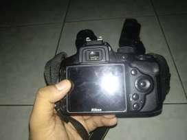 Nikon d3200 dengan lensa 18-55mm dan lensa 35mm