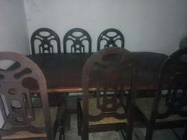 Wooden dinning table with 7 chairs