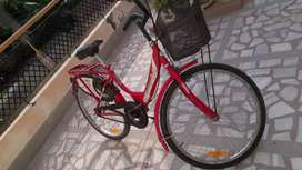 Girls magenta pink cycle with basket and stand
