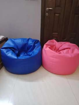 2 leather bean bags, pink and blue