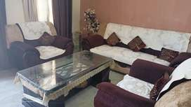 Sofa set of 5 . Brown and cream colour + one glass table good quality