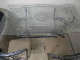 Dining table with 3 chairs for sale.