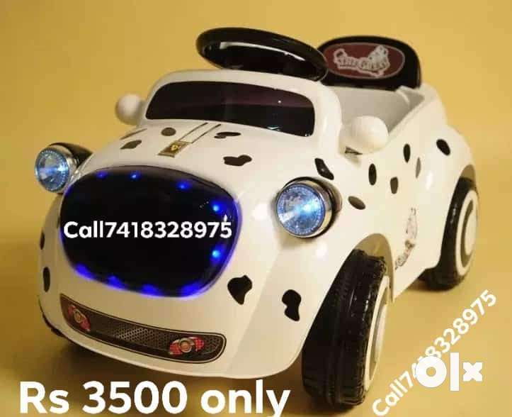 BRAND new children's ride on toy car and bike with battery 0